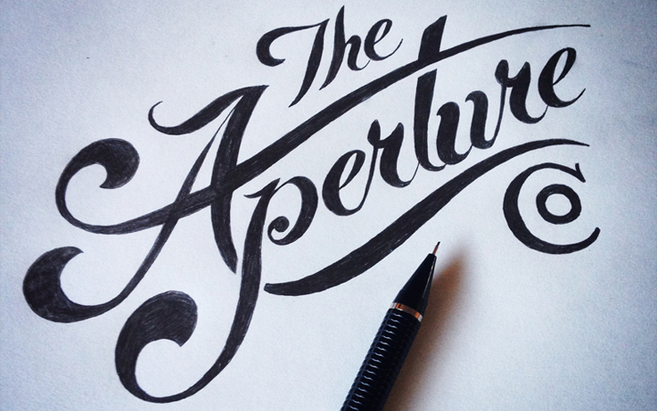 the aperture company logo calligraphy